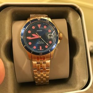 Three-Hand Date Rose Gold-Tone Stainless Stl watch